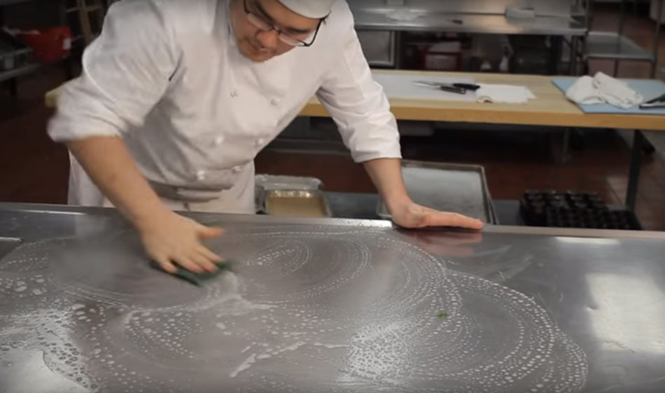 video preview image of cook cleaning a counter